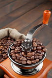 Coffee grinder with coffee beans Royalty Free Stock Photos
