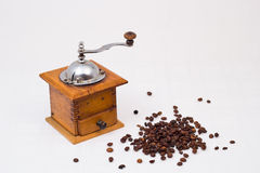 Coffee grinder with coffee beans. Retro coffee grinder and coffee beans isolated on white backgrou.nd Stock Images