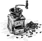 Coffee grinder with coffee beans Royalty Free Stock Images