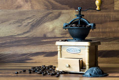 Coffee grinder with coffee beans Royalty Free Stock Photo