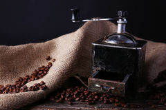 Coffee grinder with coffee beans on a brown wooden background Stock Photos