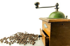 Coffee grinder with coffee beans. Isolated Stock Images