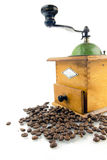 Coffee grinder with coffee beans. Isolated Royalty Free Stock Image