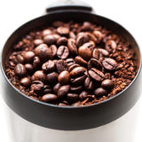 Coffee grinder with coffee beans isolated Stock Photography