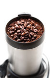 Coffee grinder with coffee beans isolated macro Royalty Free Stock Images