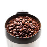 Coffee grinder with coffee beans isolated macro Royalty Free Stock Photography