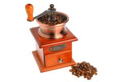 Coffee grinder with coffee beans isolated on white background Stock Image