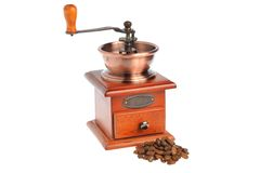 Coffee grinder with coffee beans isolated on white background Royalty Free Stock Images