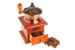 Coffee grinder with coffee beans isolated on white background Stock Images