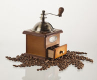 Coffee grinder with coffee beans, isolated on white background.  Royalty Free Stock Images