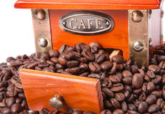 Coffee grinder with coffee beans, isolated on white Royalty Free Stock Photos