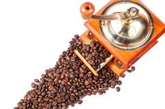 Coffee grinder with coffee beans, isolated on white Royalty Free Stock Images