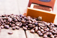 Coffee grinder and coffee beans. Royalty Free Stock Image