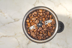 Coffee grinder with coffee beans. Top view, good copy space Royalty Free Stock Photo