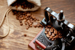 Coffee grinder and coffee beans. Vintage coffee grinder and coffee beans in burlap Stock Photos