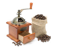 Coffee grinder and coffee beans on a white Royalty Free Stock Photos