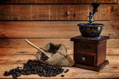 Coffee grinder and coffee beans. On  wood background Stock Photo
