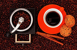 Coffee Grinder With Coffee Cup,Cookies And Cinnamon sticks Royalty Free Stock Photos