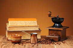 Coffee grinder, coffee pot and books Royalty Free Stock Photo