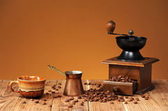 Coffee grinder, coffee pot and coffee grains Stock Image