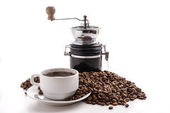 Coffee grinder with coffeecup and beans Stock Photo