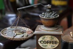 Coffee grinder. And coins, seen on a market in vietnam royalty free stock image