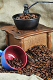 Coffee grinder and cup Stock Image