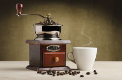 Coffee grinder with cup Royalty Free Stock Image
