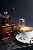 Coffee grinder and cup Stock Photo