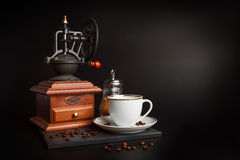 Coffee grinder and cup Royalty Free Stock Photo