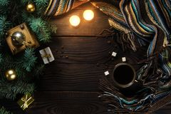 Coffee grinder, cup, candles and Christmas tree on a wooden table. Top view Stock Image