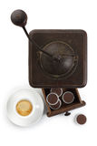 Coffee grinder with cup of coffee and capsules Royalty Free Stock Photography