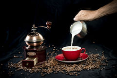 Coffee grinder and a cup of coffee Stock Photos