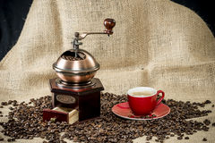 Coffee grinder and a cup of coffee Royalty Free Stock Photo