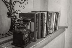 Coffee grinder and few books. stock photography