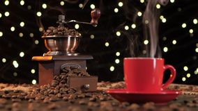 Coffee grinder filled with roasted coffee beans. Background with lights stock video footage