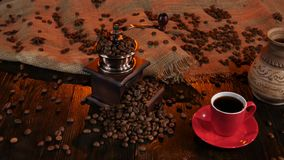 Coffee grinder full of coffee beans and cup of espresso stock video footage