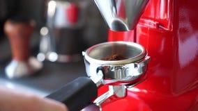 Coffee grinder grinding freshly roasted