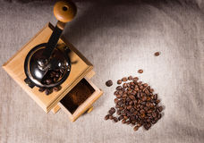 Coffee grinder, ground and beans on cloth Royalty Free Stock Photo