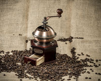 Coffee grinder on a jute bag Royalty Free Stock Images