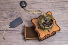 Coffee grinder with label. Image shows a coffee grinder with title block from a top view stock photos