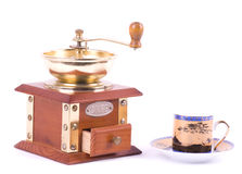 Coffee grinder and little coffee cup Royalty Free Stock Image