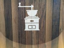Blackboard coffee grinder icon on wooden background. stock photo