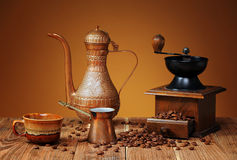 Coffee grinder and metal dishes Stock Image
