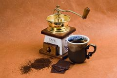 Coffee grinder, mug, chocolate Royalty Free Stock Photo