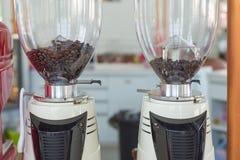 Coffee grinder preparing to grind coffee in cafe.  Royalty Free Stock Photos