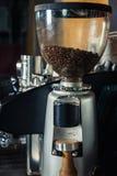Coffee grinder preparing to grind coffee. In bar Stock Images