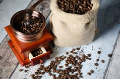 Coffee grinder with roasted beans. Vintage mill composition Stock Photography