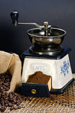 Coffee grinder and roasted coffee beans Stock Images