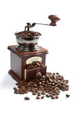 Coffee grinder and roasted coffee beans isolated Royalty Free Stock Photo